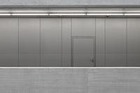 Closed door on metallic wall in office 11016035909| 写真素材・ストックフォト・画像・イラスト素材|アマナイメージズ