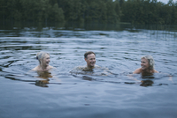 Happy friends enjoying in lake