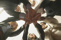 Group of business executives in a huddle