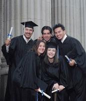 graduates standing outside