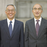 Two Asian businessmen posing posing