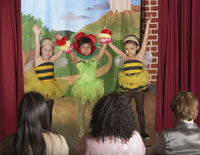 girls in bee and flower costumes