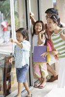 Asian family window shopping