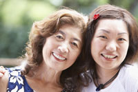 Asian mother and adult daughter