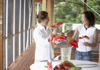 mother and daughter arranging flowers