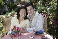 Couple hugging at outdoor table