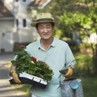 Senior Asian man gardening