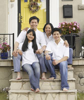 Portrait of Asian family on porch