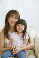 Asian mother and daughter hugging