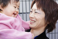 Asian mother smiling at baby