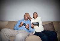 African couple playing video game