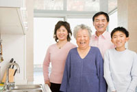 Chinese family smiling in kitchen