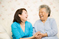 Chinese mother and daughter laughing