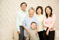 Chinese multi-generational family smiling