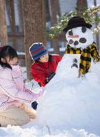 Japanese children building snowman