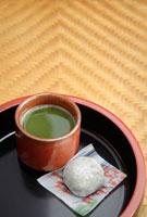 Japanese green Matcha tea and mochi sweet on tray