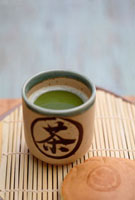 Close up of Japanese green Matcha tea and red bean pastry