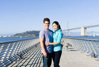 Couple hugging on pier at waterfront