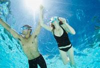 Couple swimming in swimming pool