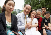 Chinese family sitting together outdoors