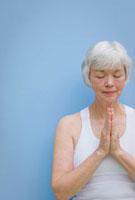 Mixed race woman praying