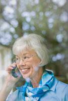 Mixed race woman talking on telephone