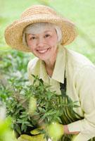 Mixed race woman working in garden
