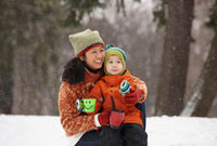 Chinese mother hugging son in the snow