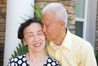 Senior Chinese man kissing wife