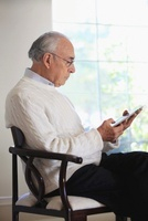 Hispanic man using digital tablet