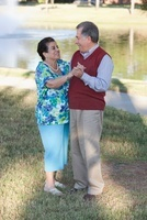 Hispanic couple dancing outdoors