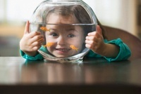Caucasian girl holding fish bowl