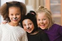 Smiling girls in Halloween costumes