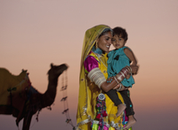 Indian woman in traditional clothing holding daughter