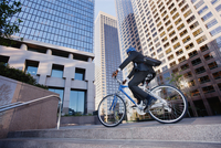 Businessman riding bicycle in city