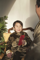 Chinese boy in traditional Chinese clothing