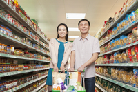 Chinese couple shopping in grocery store