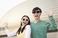 Chinese couple in heart-shaped glasses