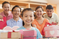 Chinese family smiling at birthday party