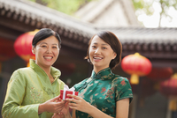 Chinese mother and daughter giving gifts