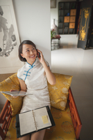 Chinese businesswoman working in traditional clothes