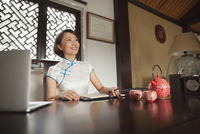 Chinese businesswoman working at desk