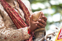 Indian groom holding coconut
