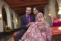 Indian newlywed couple smiling