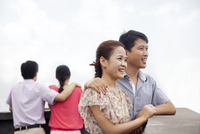 Chinese couples standing on rooftop