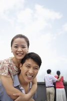 Chinese couple smiling on rooftop