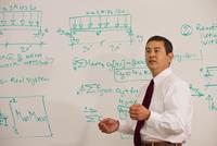 Japanese teacher standing in front of whiteboard