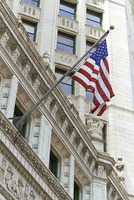 American flag hanging from ornate building