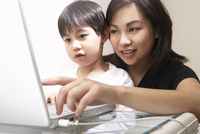 Filipino mother and son using laptop together