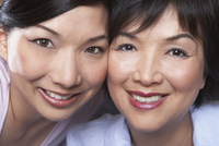 Chinese mother and daughter smiling